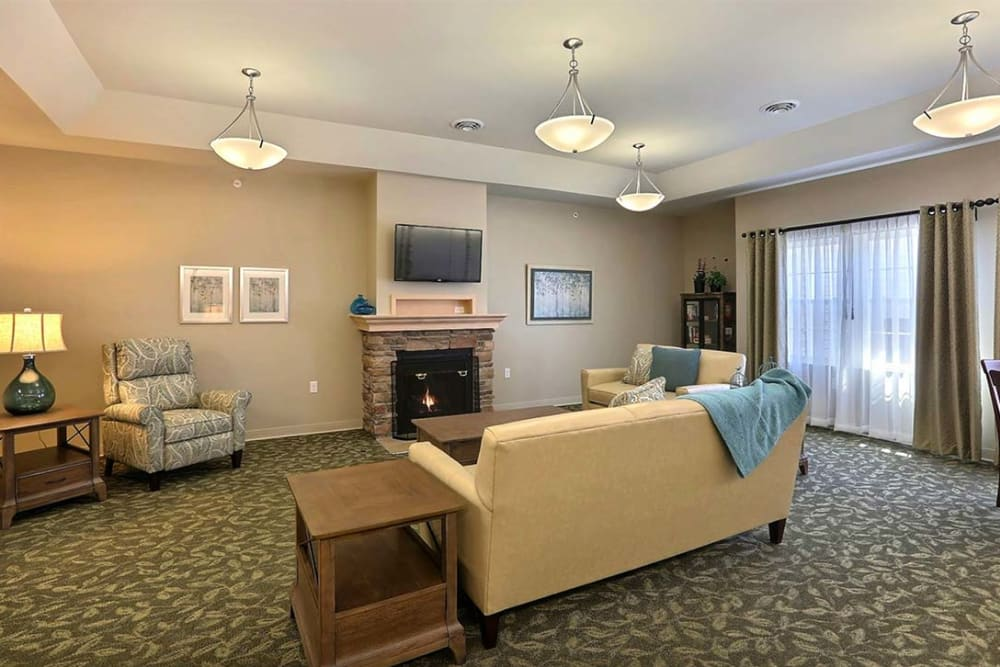 Bright community TV room at Milestone Senior Living in Stoughton, Wisconsin.