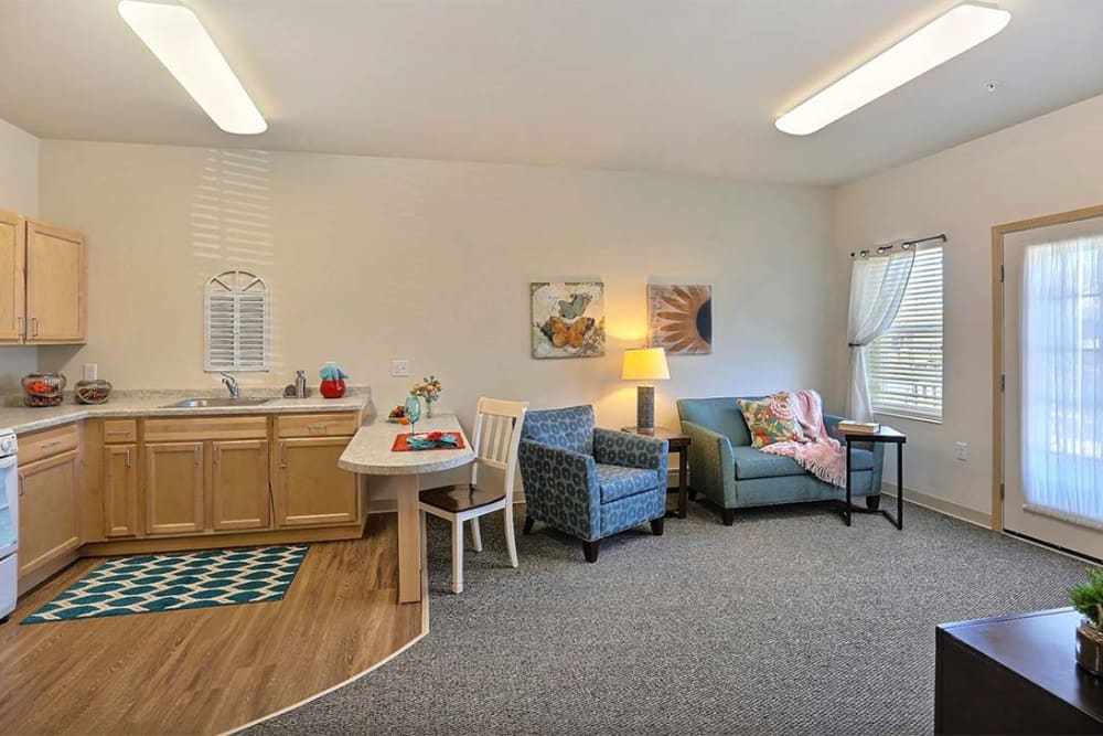 Open floor plans with a kitchen at Milestone Senior Living in Stoughton, Wisconsin.