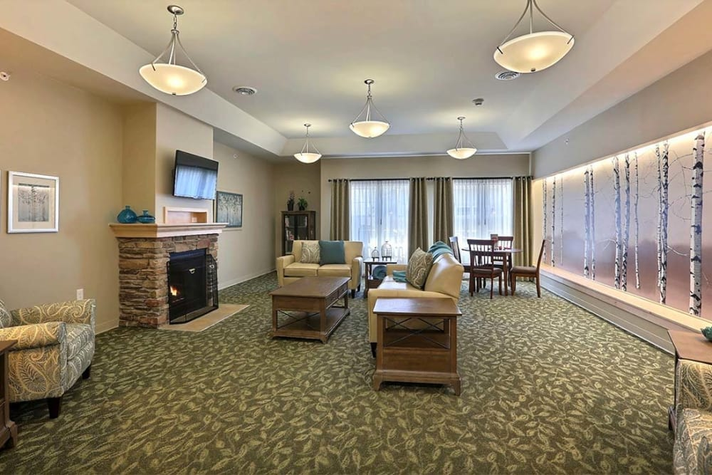 Activity room with TV and fireplace Milestone Senior Living in Stoughton, Wisconsin.