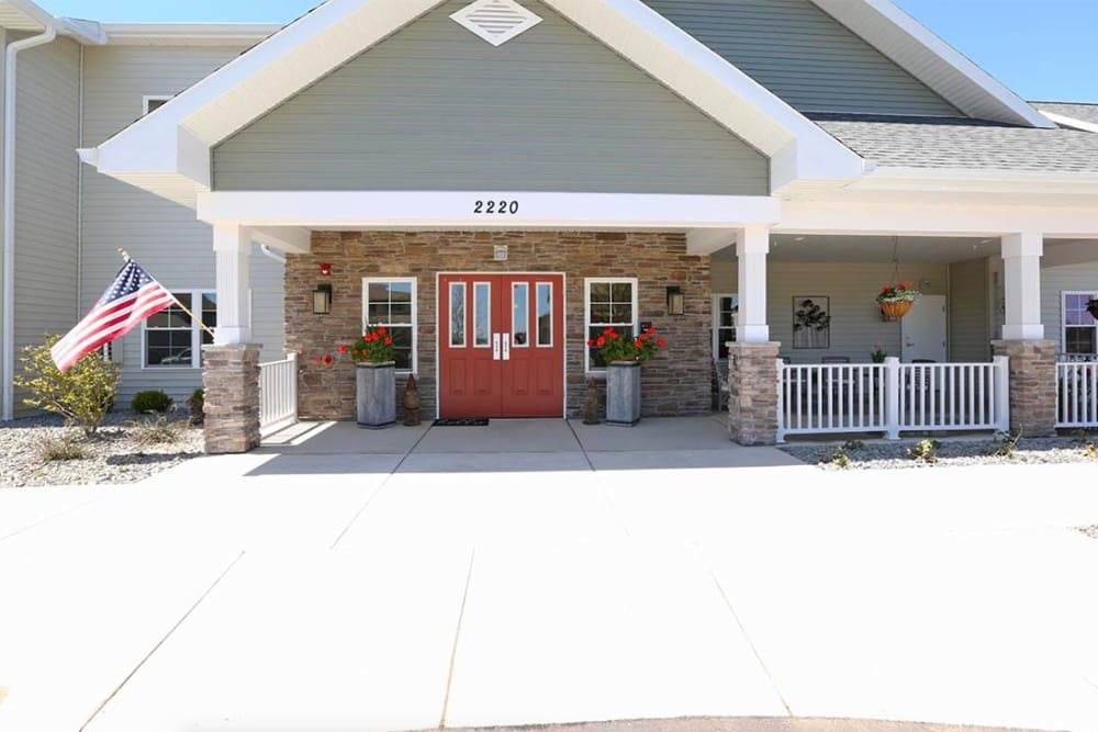 Main entrance and covered porch at Milestone Senior Living in Stoughton, Wisconsin.