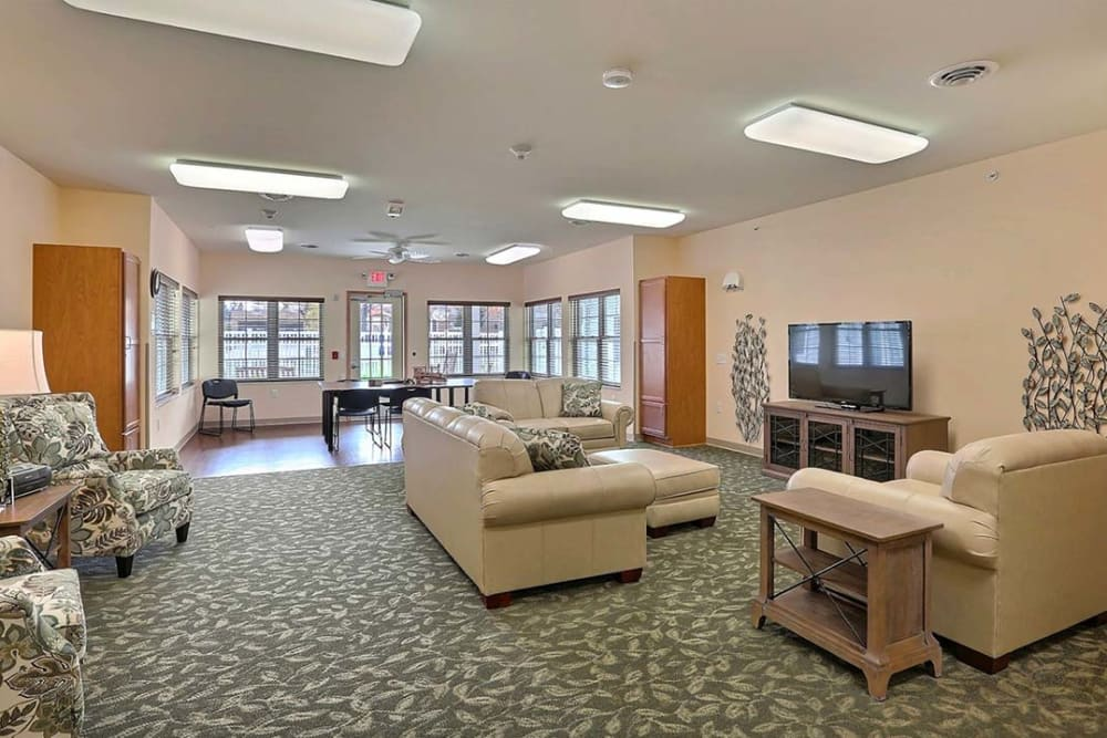 Community room with TV at Milestone Senior Living in Tomahawk, Wisconsin.