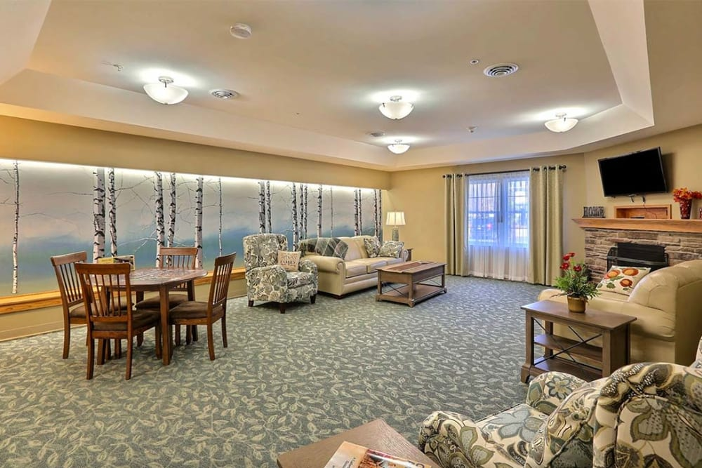 Activity lounge with games and TV at Milestone Senior Living in Tomahawk, Wisconsin.