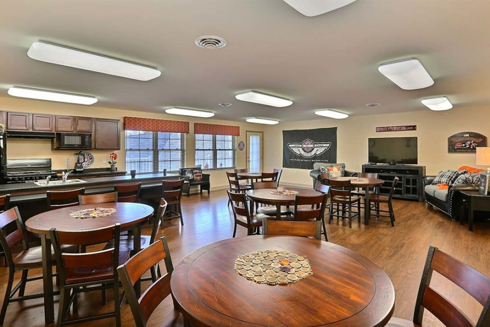 Activity room with kitchenette and TV at Milestone Senior Living in Tomahawk, Wisconsin.