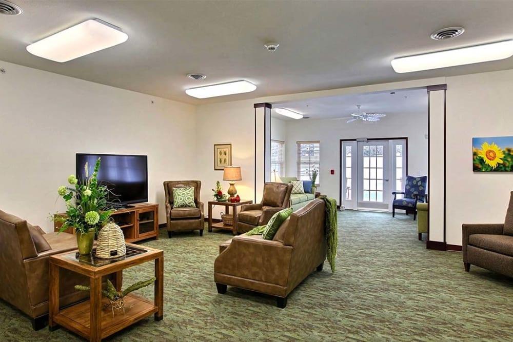 Community lounge with TV at Milestone Senior Living in Woodruff, Wisconsin.