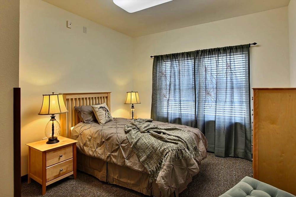 Resident bedroom at Milestone Senior Living in Woodruff, Wisconsin.