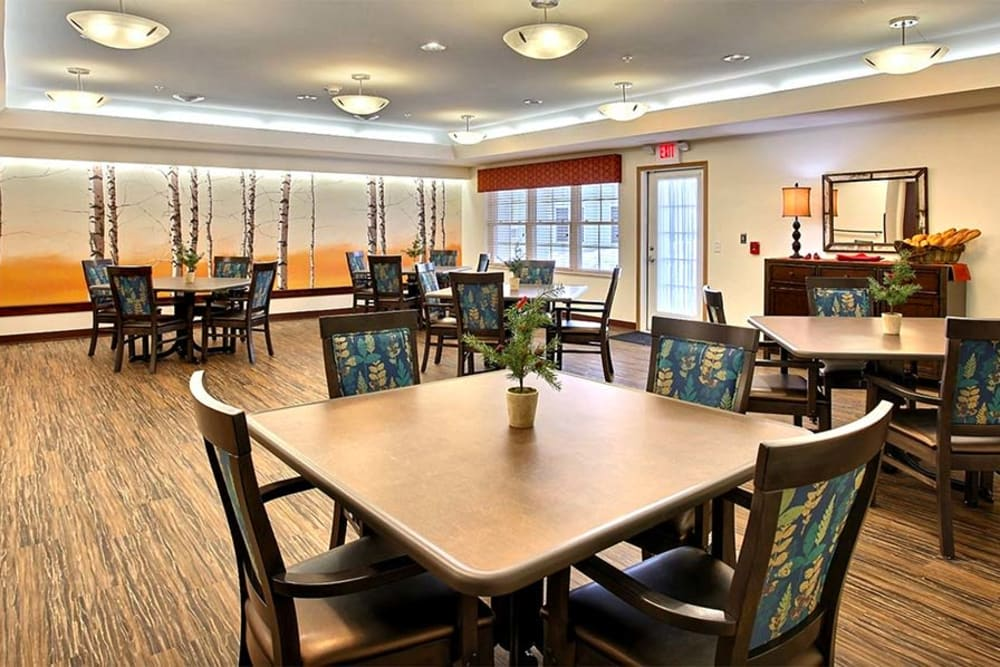 Spacious resident dining room at Milestone Senior Living in Woodruff, Wisconsin.