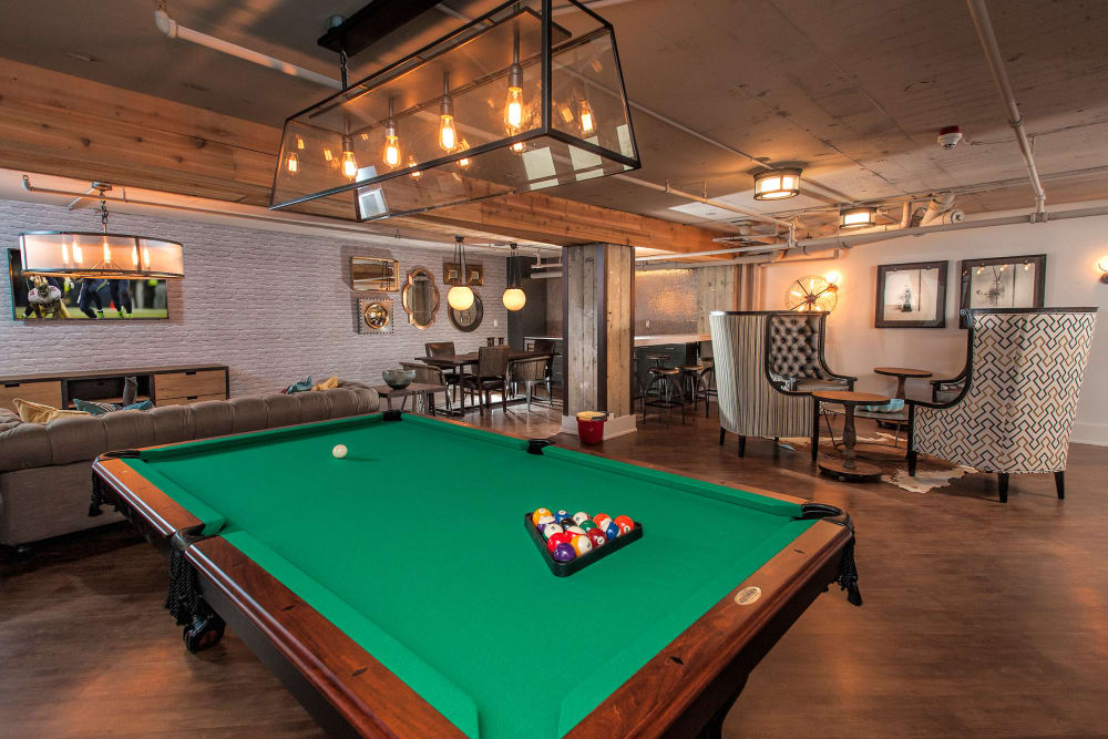Billiards table with comfortable seating at The Mill at First Hill in Seattle, Washington