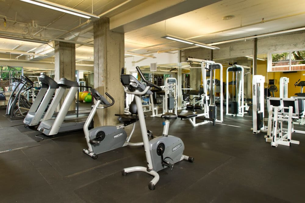 Fitness center with individual work stations at The Mill at First Hill in Seattle, Washington