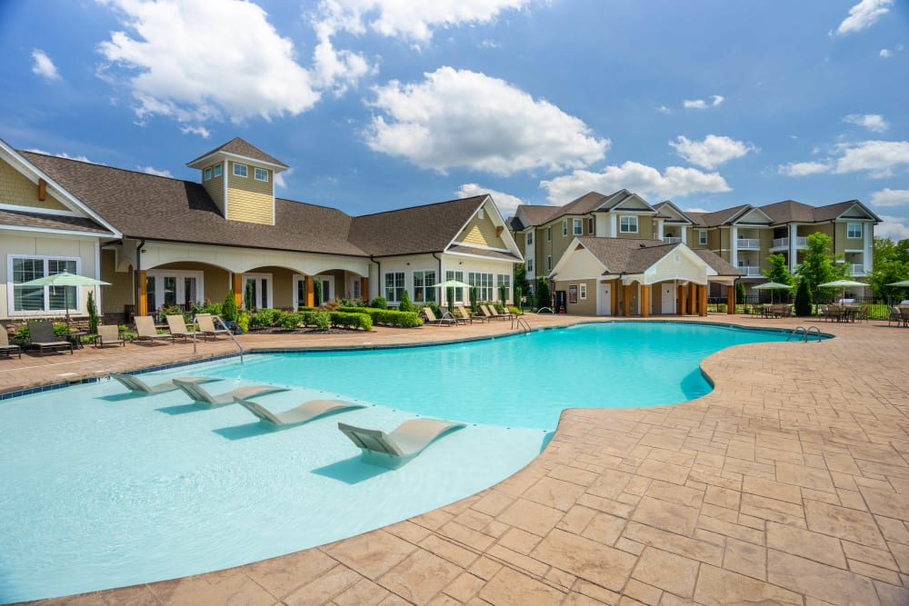 Resort-style swimming pool with in-pool sun deck at Legends at White Oak in Ooltewah, Tennessee