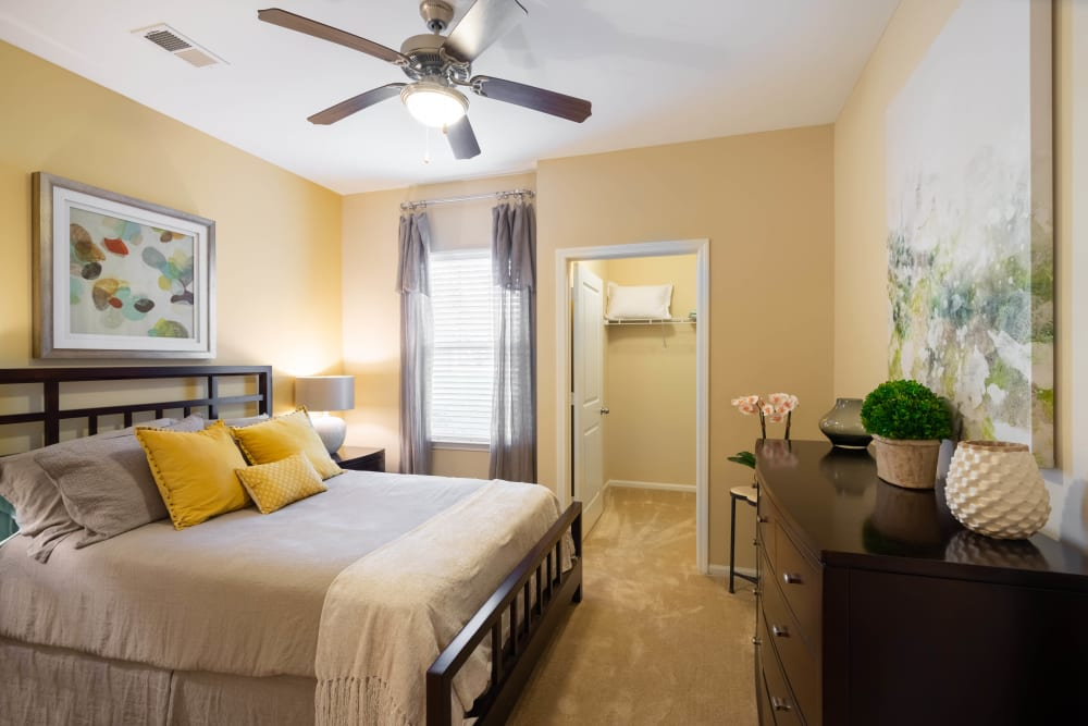 Well-furnished master bedroom at Legends at White Oak in Ooltewah, Tennessee