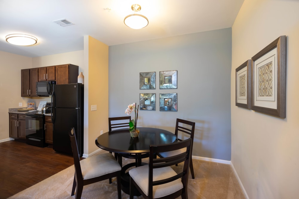Dining area with an accent wall in a model home at Legends at White Oak in Ooltewah, Tennessee