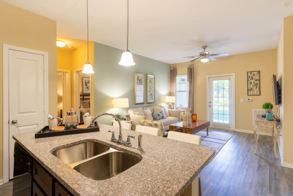 View of the living area from the open-concept kitchen of a model home at Legends at White Oak in Ooltewah, Tennessee