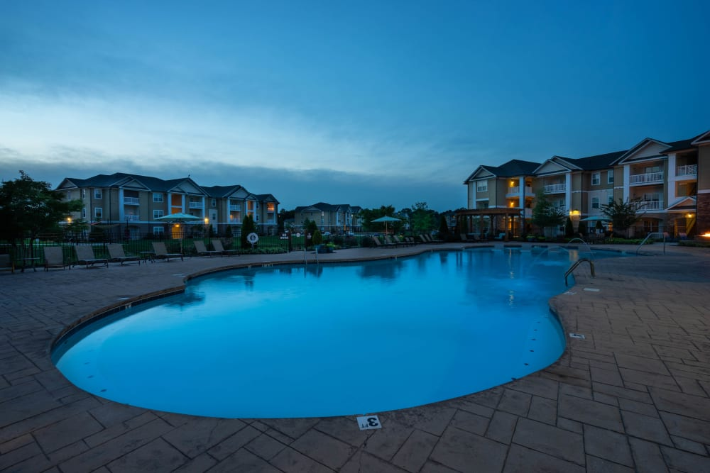 View of the pool area at dusk at Legends at White Oak in Ooltewah, Tennessee