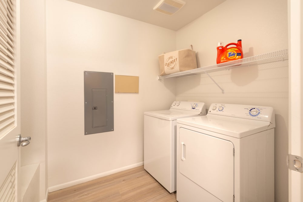 In-unit washer and dryer in a model home at Olympus at Daybreak in South Jordan, Utah