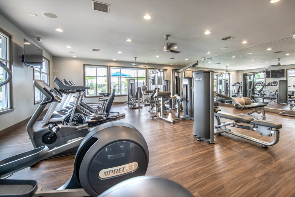 Well-equipped onsite fitness center at Olympus at Daybreak in South Jordan, Utah