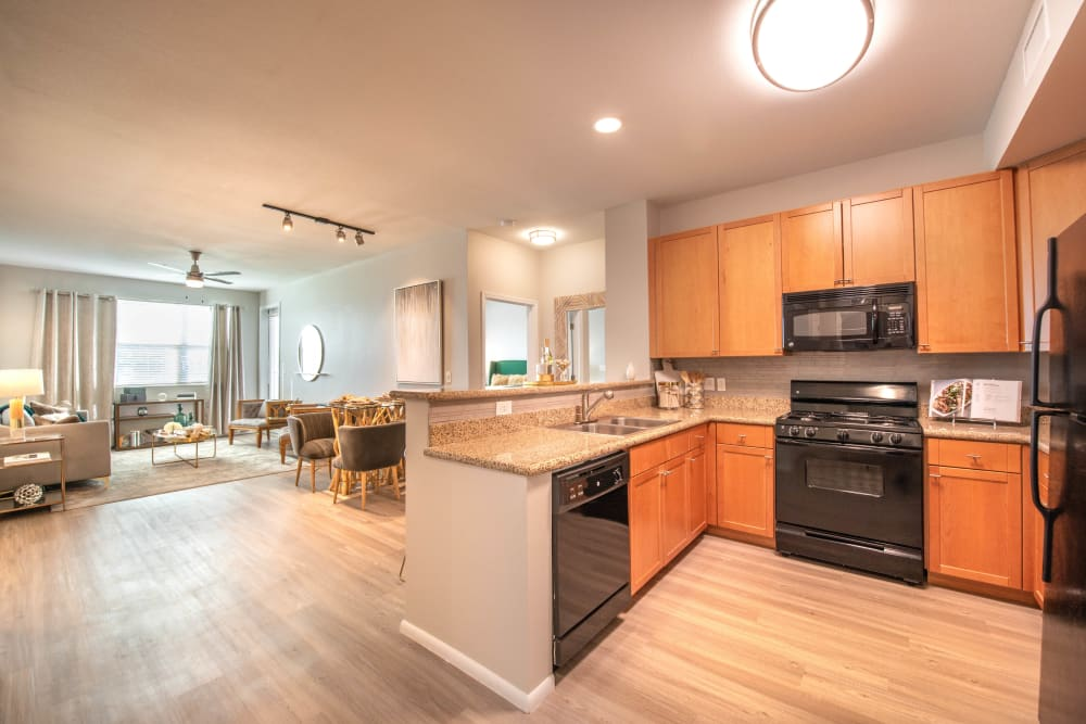 Gourmet kitchen with granite countertops in a model apartment at Olympus at Daybreak in South Jordan, Utah