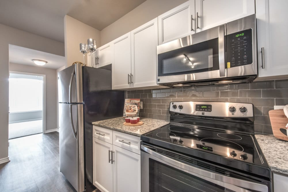 Stainless-steel kitchen appliances available at Olympus 7th Street Station in Fort Worth, Texas