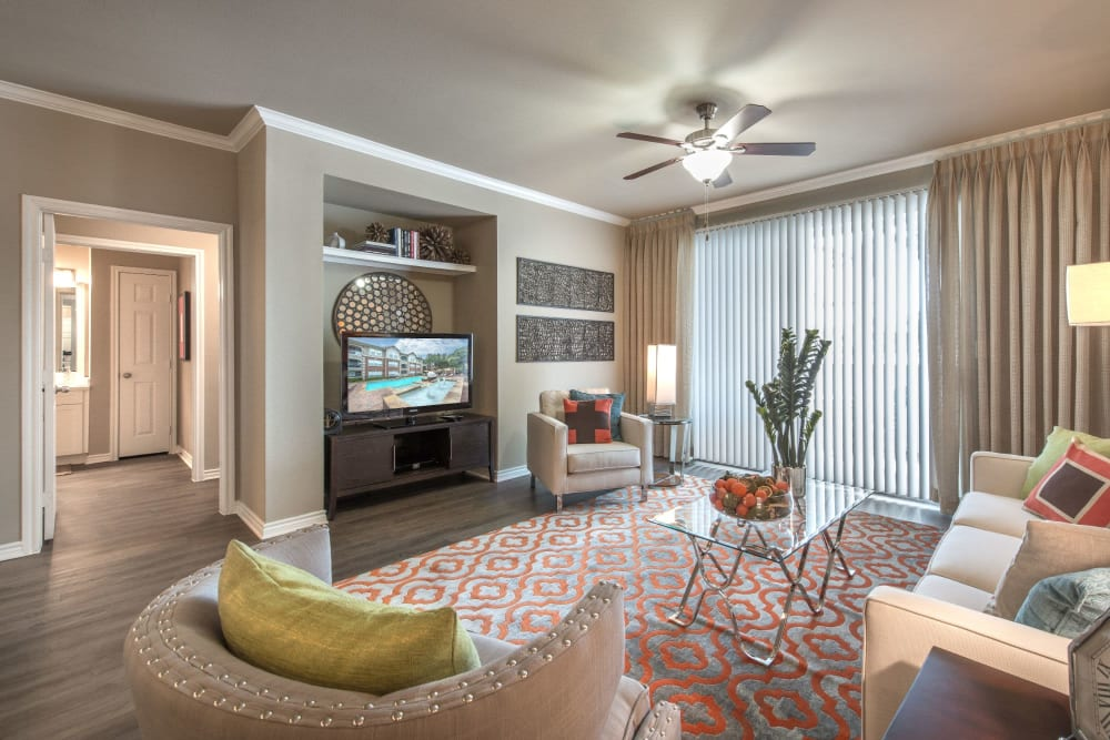 Spacious living room area at Olympus 7th Street Station in Fort Worth, Texas