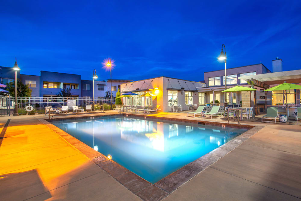 Evening view of the swimming pool at Olympus at Daybreak in South Jordan, Utah
