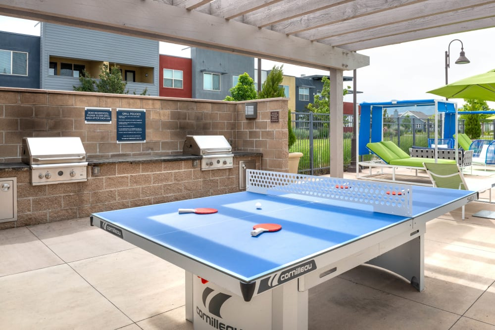 Ping pong table near the barbecue area with gas grills at Olympus at Daybreak in South Jordan, Utah