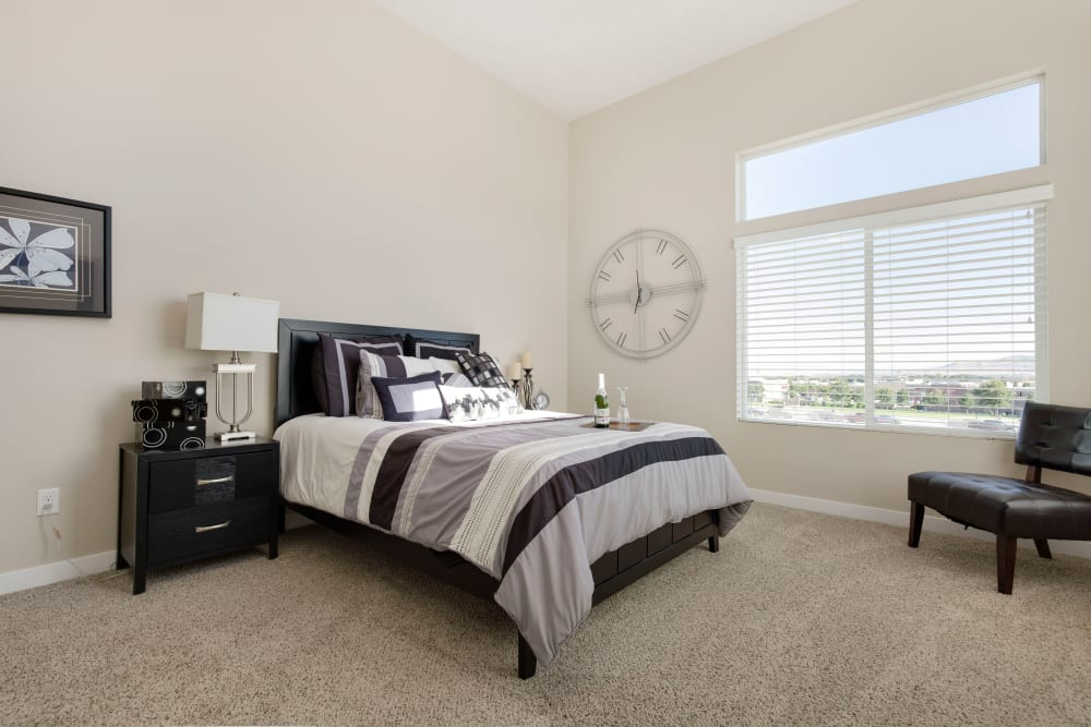 Well-lit bedroom of Olympus at the District in South Jordan, Utah