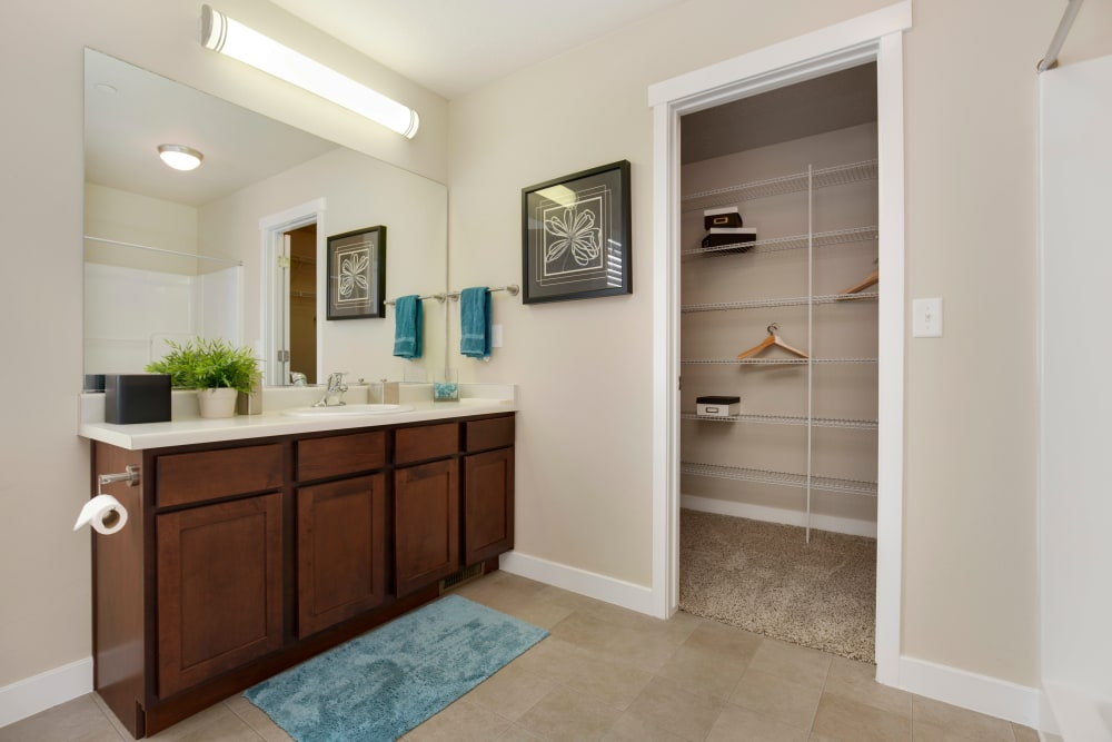 Bathroom and walk-in closet of Olympus at the District in South Jordan, Utah