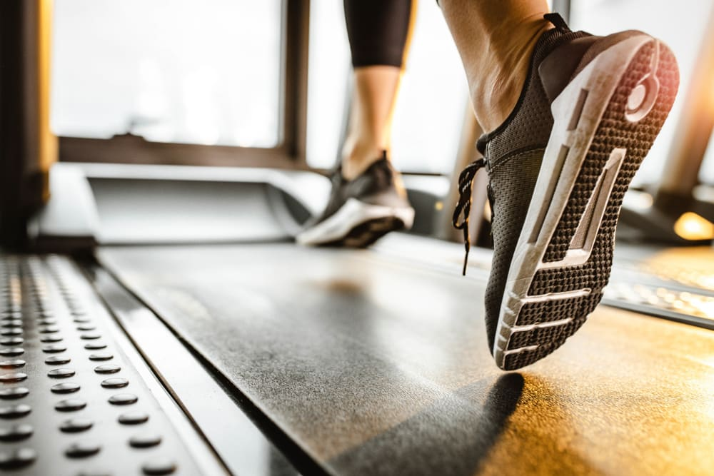Resident getting her steps in on the treadmill at the fitness center at Cortland Village Apartment Homes in Hillsboro, Oregon