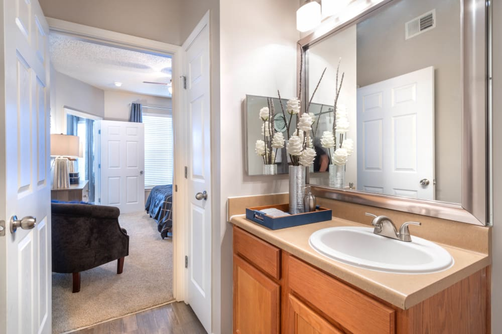 Guest bathroom with a large vanity mirror in a model apartment at Olympus Fenwick in Savannah, Georgia