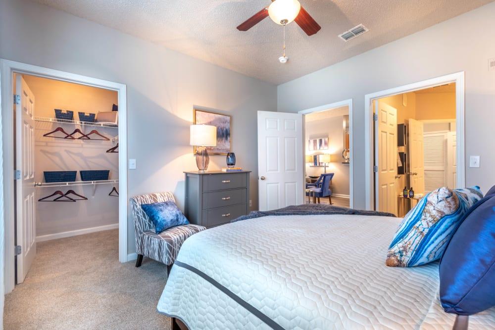 Walk-in closet and an en suite bathroom in a model home's master bedroom at Olympus Fenwick in Savannah, Georgia