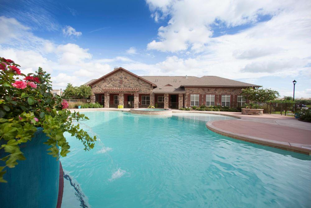 Resort-style swimming pool at Olympus Katy Ranch in Katy, Texas