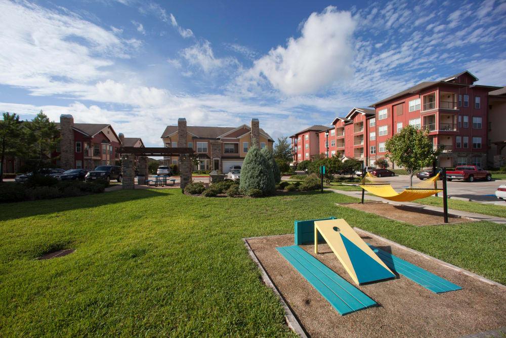 Cornhole court and hammocks at the resident park at Olympus Katy Ranch in Katy, Texas