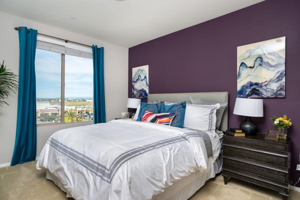 Well-lit bedroom at Olympus Corsair in San Diego, California