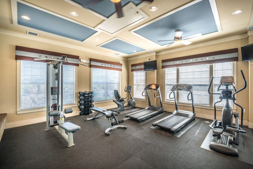 Fitness equipment in the onsite gym at Odyssey Lake in Brunswick, Georgia