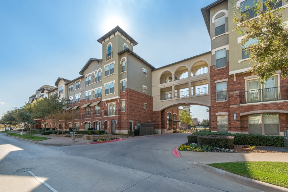 View of the entrance to our luxury community from across the street at Olympus Las Colinas in Irving, Texas