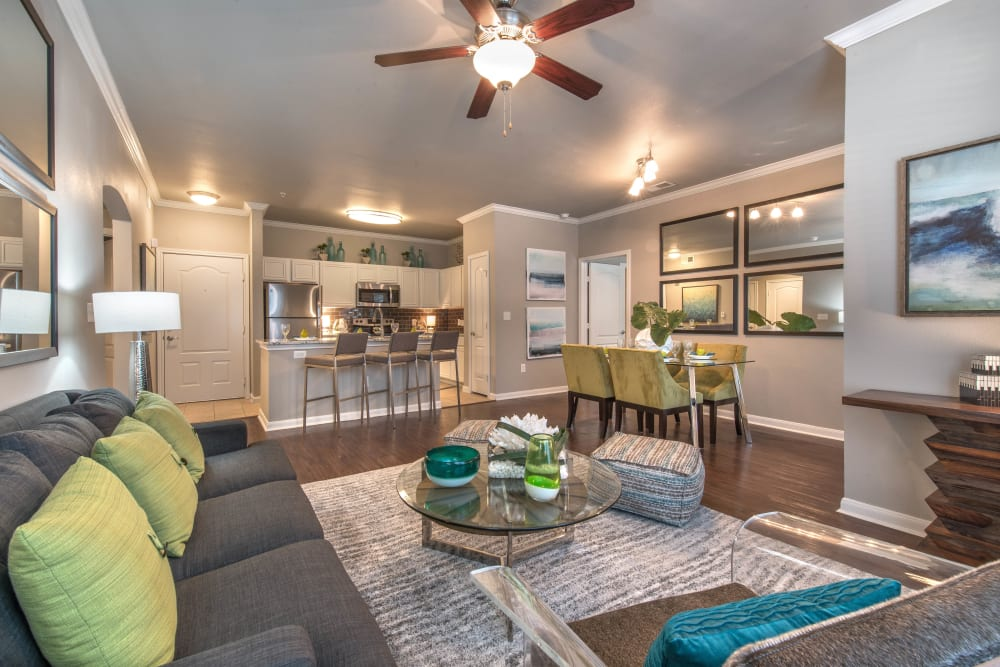 Spacious and well-furnished open-concept living area in a model apartment at Olympus Las Colinas in Irving, Texas