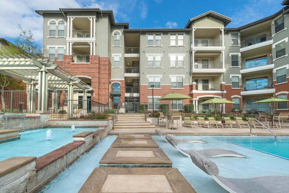 In-pool sun deck at Olympus Las Colinas in Irving, Texas