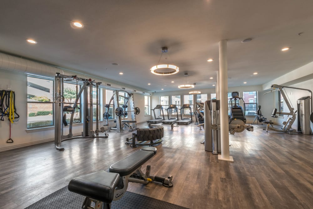 Spacious fitness center with a variety of exercise equipment at Olympus Las Colinas in Irving, Texas