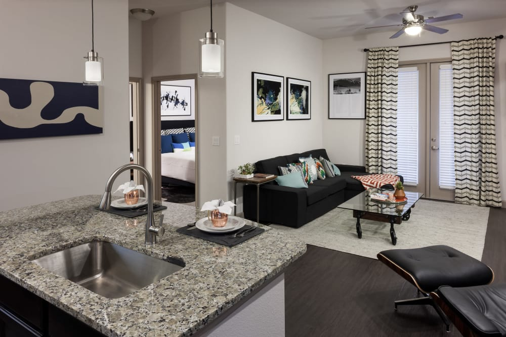 View of the living room in model home at Olympus Auburn Lakes in Spring, Texas