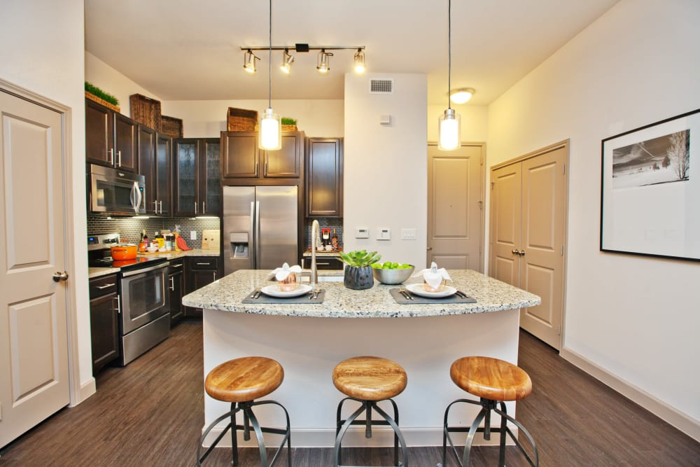 Kitchen island with bar stools at Olympus Auburn Lakes in Spring, Texas