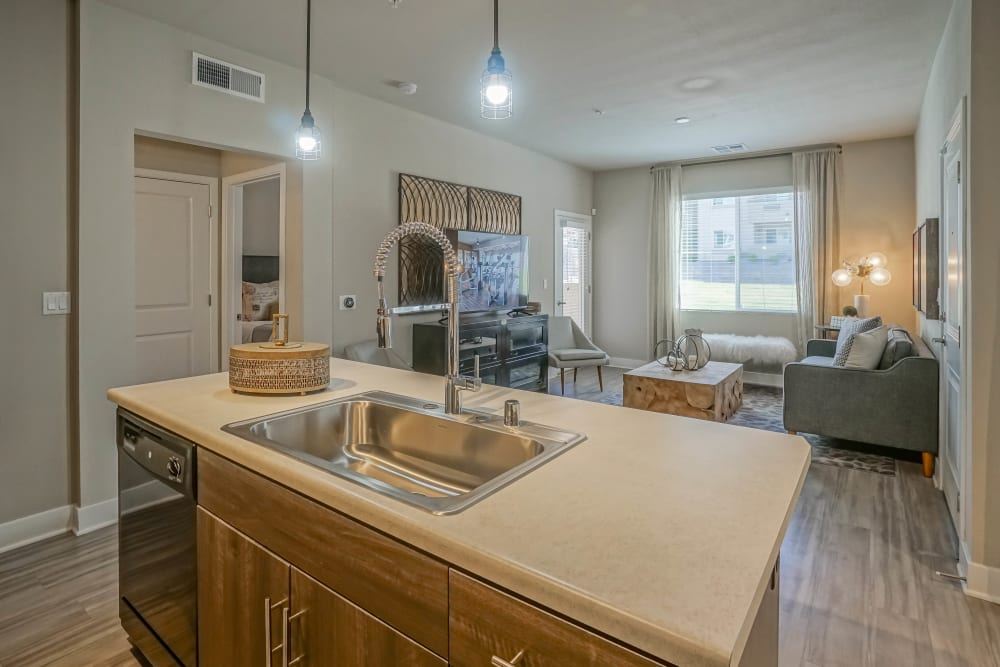 Open-concept kitchen and living area in a model home at Olympus Northpoint in Albuquerque, New Mexico
