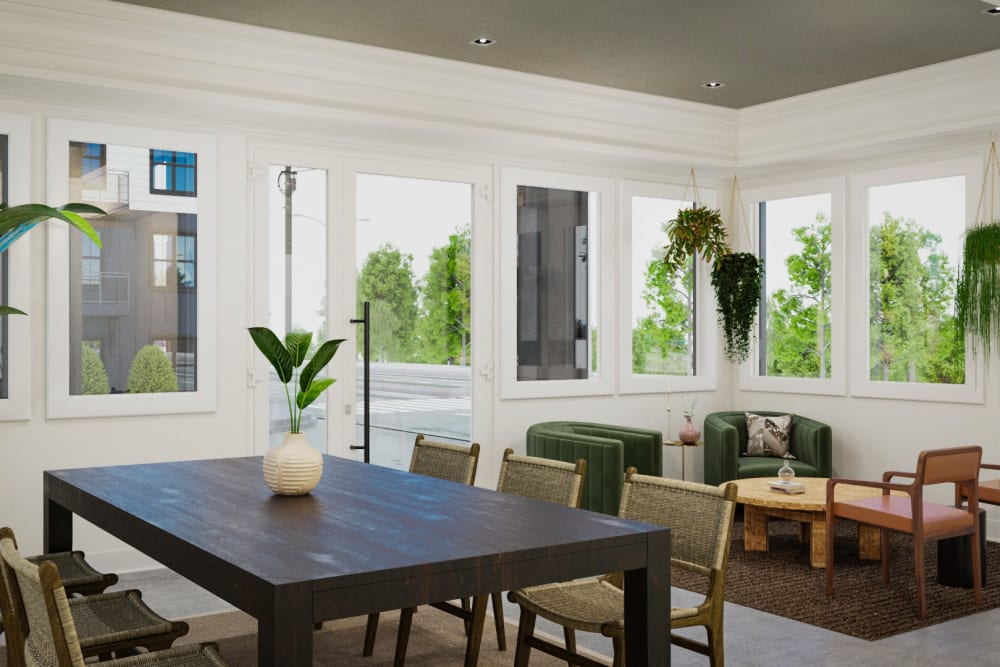 Rendering of living room and dining room interior with large windows for abundant natural light at Arcadia Decatur in Decatur, Georgia