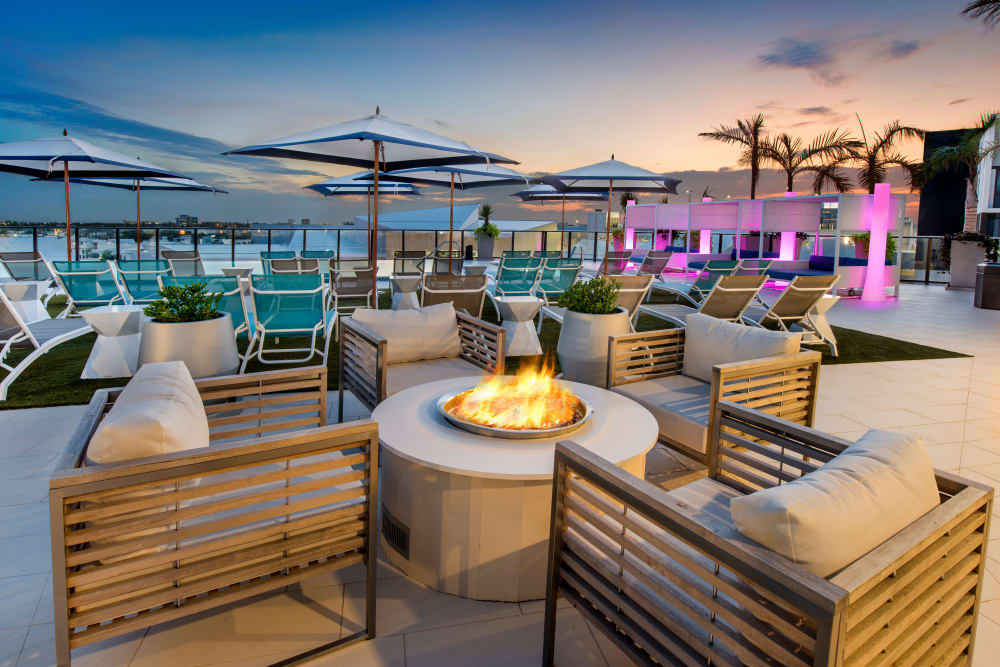 Outdoor lounge with a firepit at The Flats in Doral, Florida