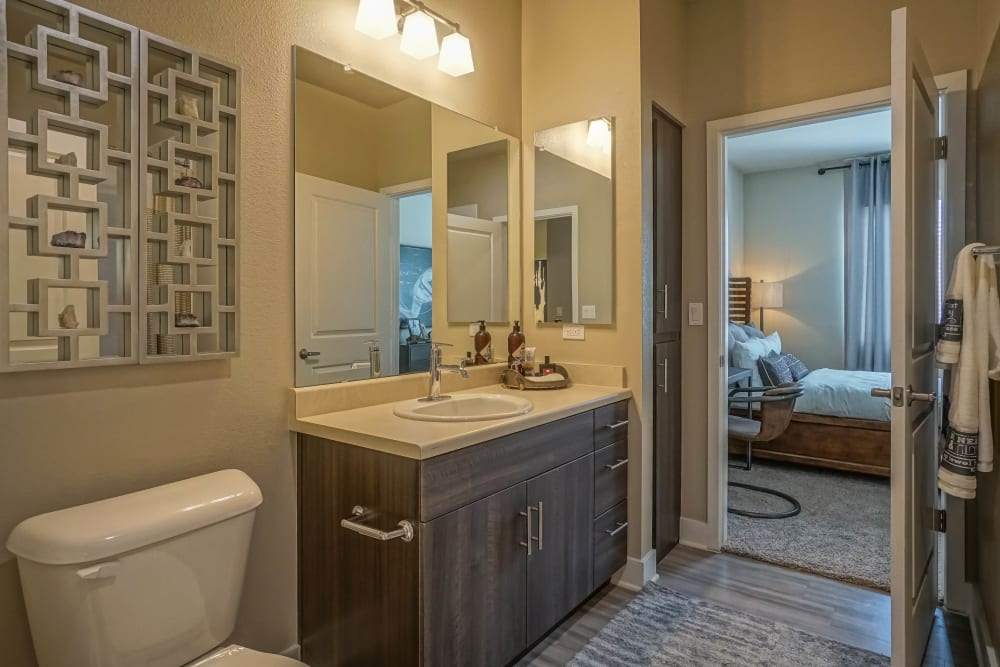 Quartz countertop and a large vanity mirror in a model home's master bathroom at Olympus Northpoint in Albuquerque, New Mexico