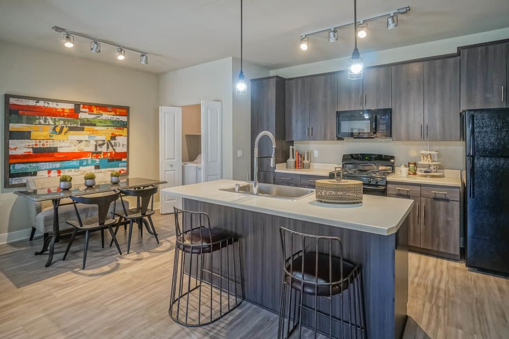 Custom lighting above the kitchen island in a model townhome at Olympus Northpoint in Albuquerque, New Mexico