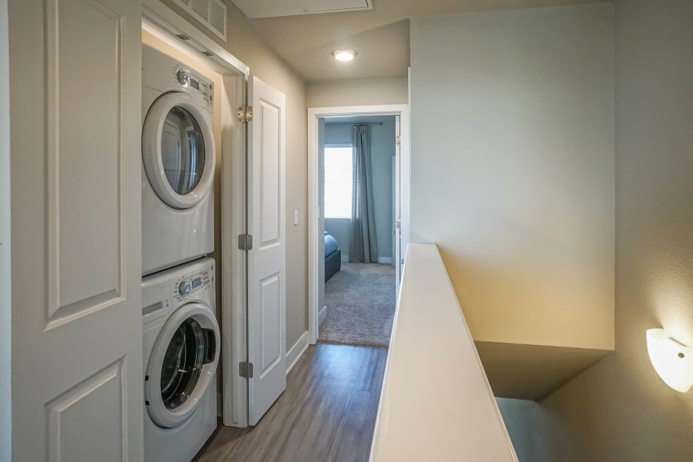 Model apartment's in-unit washer and dryer at Olympus Northpoint in Albuquerque, New Mexico
