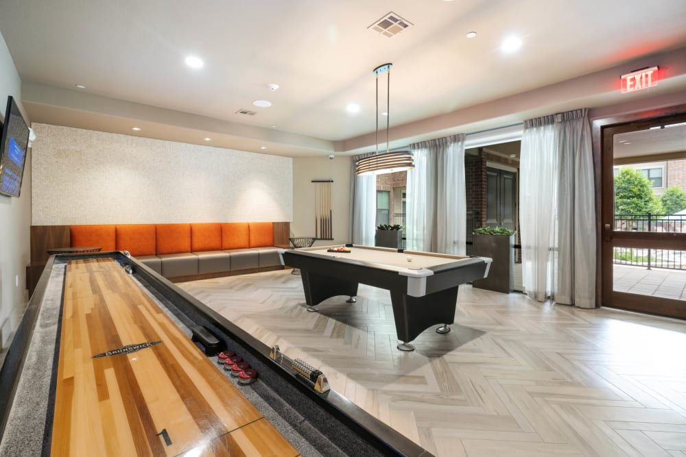 Tabletop shuffleboard and billiards in the game room at Olympus Sierra Pines in The Woodlands, Texas