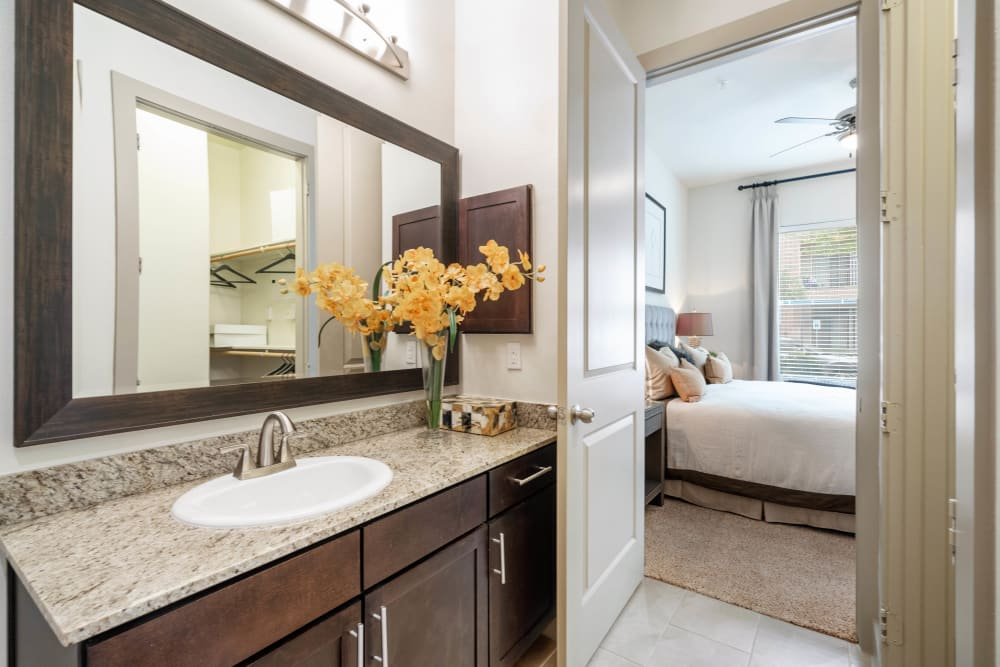 Oversized vanity mirror in a model home's master bathroom at Olympus Sierra Pines in The Woodlands, Texas