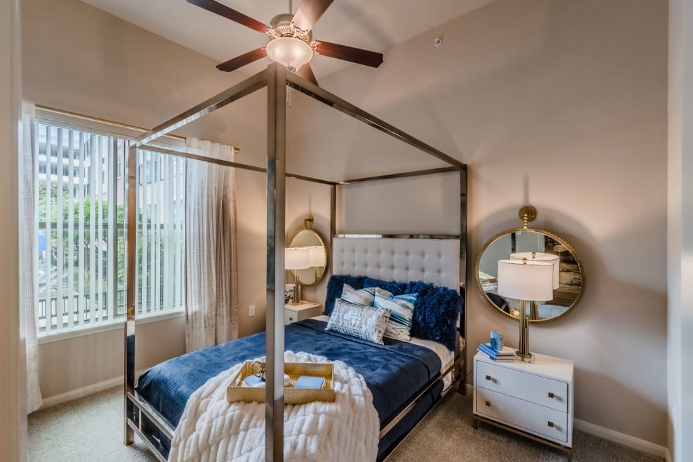 Bedroom with large windows at Olympus Boulevard in Frisco, Texas