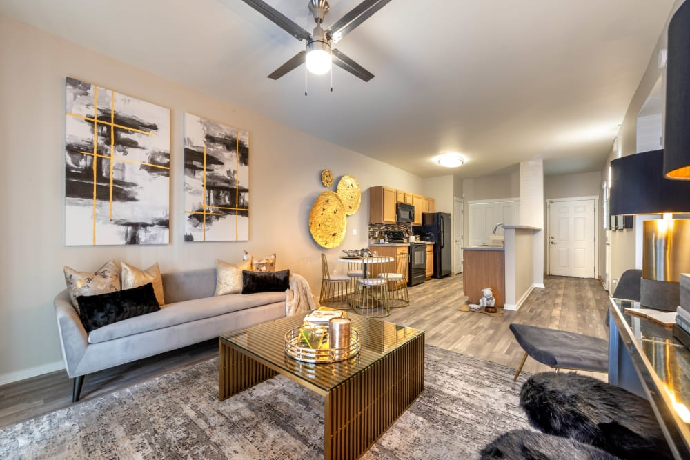 Well-furnished model home's living area with hardwood floors at Olympus Solaire in Albuquerque, New Mexico