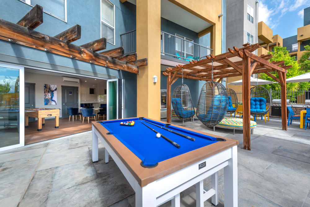 Outdoor billiards table at Olympus Solaire in Albuquerque, New Mexico